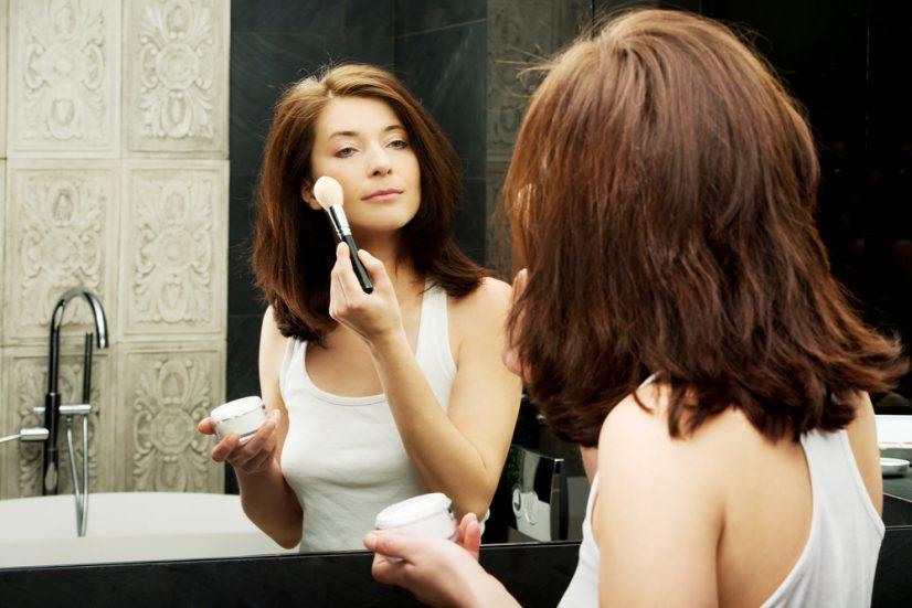 Applying Makeup in Mirror Photo