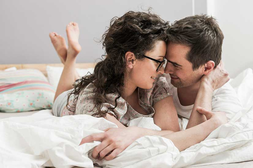 Couple On Bed Photo
